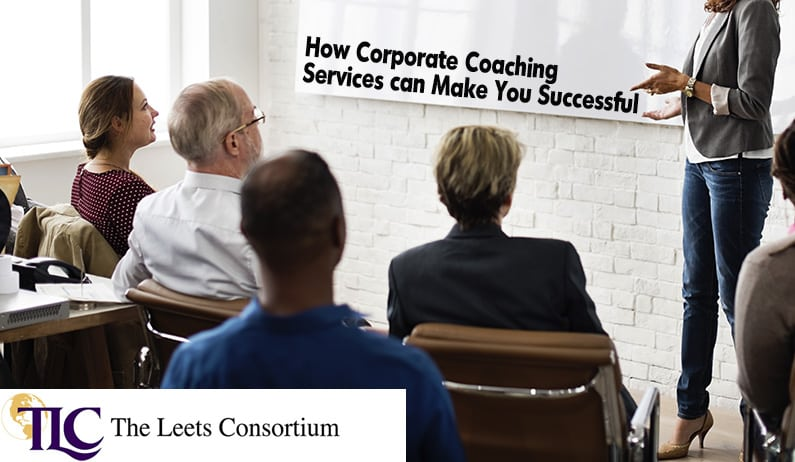 coach in front of executives